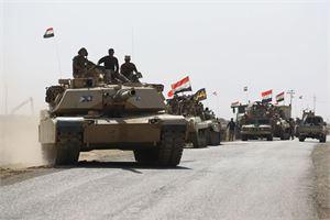 Irakin hallinnon joukot tavoittelevat pääsyä Kirkukiin. LEHTIKUVA/AFP