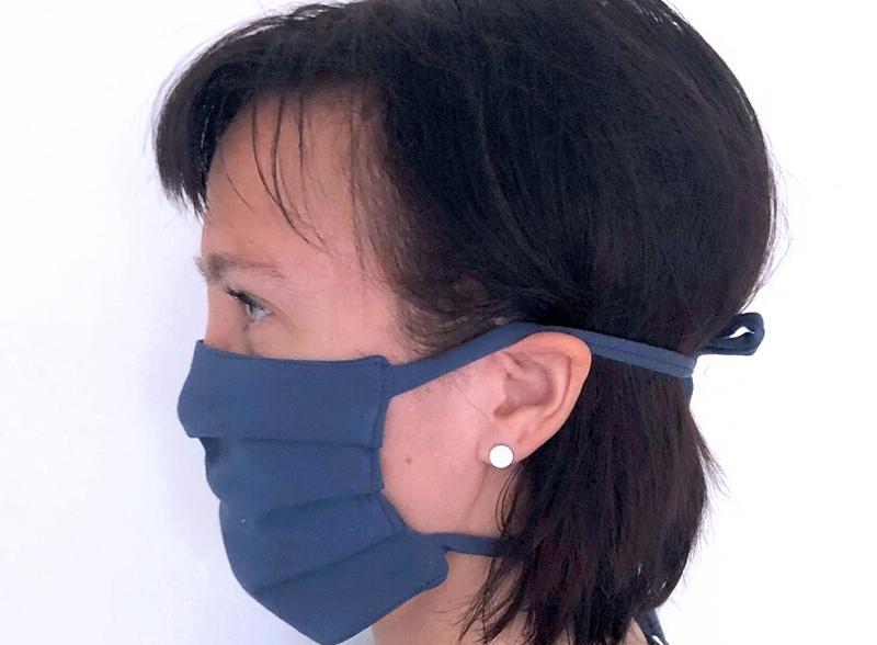 Kasvomaski saattaa suojata muita ihmisiä maskin käyttäjän virustartunnalta.